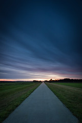 Following (Benjamin Tau) Tags: blue trees sun green clouds canon grey sonnenuntergang dusk path wiesen fields bume 1022 oldenburg weg bornhorst bornhorsterwiesen