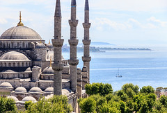 The Blue Mosque (Sultan Ahmet Camii) and the blue sea, Istanbul Turkey (Maria_Globetrotter) Tags: world old city travel trees light summer panorama heritage tourism beautiful sunshine architecture canon wonderful landscape golden boat photo spring cool nice europe day sailing angle cloudy capital türkiye wide style pic visit istanbul mosque aerial unesco turquie türkei april mezquita strong classical tele late lonely greatest ottoman horn turkish islamic vackra sommar turquía bahar landskap 2014 güzel welterbe turcja dünya turkiet vacker haliç 600d moské 1585 img8653 världsarv moskén mariaglobetrotter mirasları 伊斯坦布尔turkey