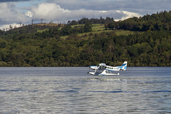 Lomond Liftoff (Kev Gregory (General)) Tags: seaplane aircraft loch lomond scotish highlamds scotland reflections hills trees green mountains sky clouds scenic scenery kev gregory canon 7d cessna 208 caravan glaud