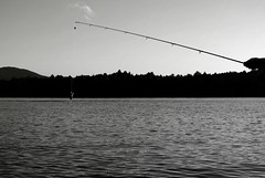 Fishing (mimileduck) Tags: fish fishing summer lake lakehouse trees sky outside outdoor travel adventure water ripples mountain hill cloud blackandwhite light dark hand pole fishingpole