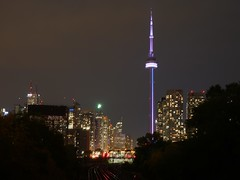 View from the side. (Leszek Wronski) Tags: leszekwronski cntower downtown skyline outdoor toronto night tower traintracks nightview panasoniclumixdmcg7 panasonicdmcg7 panasonicg7 panasonic lumixdmcg7 lumixg7 lumix mft m43 g7