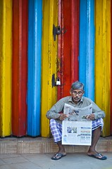 Newspaper reader! (ashik mahmud 1847) Tags: bangladesh d5100 nikkor colorful background line people newspaper morning man street