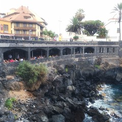 Puerto de la Cruz, Tenerife (alessandrabee1) Tags: volcanicrocks wanderlust placestosee town rocks oceanview ocean canaryislands tenerife restaurant