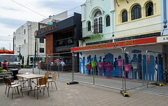 More Barriers to Go Up Here (Jocey K) Tags: newzealand christchurch buildings city signs architecture people street newregentst cafes chairs tables shops mural streetart painting artwork truck bells