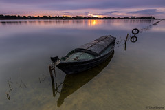 Canes & Mud XIV. (dasanes77) Tags: canoneos6d canonef1635mmf4lisusm tripod landscape seascape cloudscape clouds dawn sunrise horizon water lake diagonal underwaterplants canes mud canesmud valencia albuferaofvalencia calm boat old peace tranquility longexposure