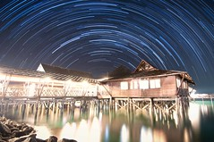 Star Trails @ Kelong (Olegna.NET) Tags: blue light sky house black reflection water night indonesia happy star nikon long path tripod first excited reservoir trail astrophotography pollution astronomy remote resorts ark 1224mm nocturne trigger bintan startrails riau nirwana startrail d90 intervalometer olegnanet starstax