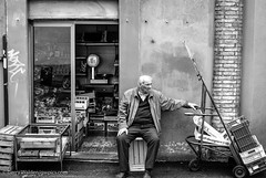 Just Resting (gwpics) Tags: street old people blackandwhite italy food white black building monochrome shop work relax mono store italian europe european commerce labor streetphotography eu vegetable elderly age tired ita shops labour leisure aged relaxation trade perugia pleasure umbria editorialuseonly