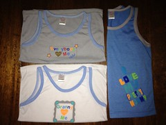 "Cute sleeveless shirts for your little one with phrases such as ""Everybody Loves Me"", ""Granny Loves Me"", and ""I Love My Pretty Mommy."" :) (Travel Galleries) Tags: blue boy summer baby white t grey cool toddler funny shirts cotton tees phrases sleveless"