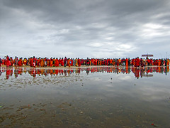 Sea of Red (Ragavendran / Rags) Tags: red people beach clouds reflections religious rainyday religion celebration indians marinabeach hinduism tamilnadu reddress rainclouds cwc seaofred indianlife beautifulindia tamiltradition chennaiweekendclickers ragavendran