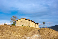 A house in the countryside (Mikel Martnez de Osaba) Tags: blue light sky sunlight house mountain building field yellow stone rural countryside path farm farming rustic meadow sunny trail
