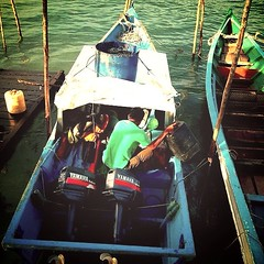 Filling the tank before fishing (mie_sal75) Tags: sea nature water boats engines sarawak yamaha kampung horsepower sematan
