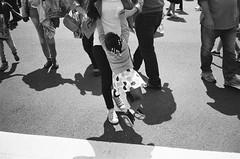 Swing Me! (Eric Spiegel) Tags: city urban blackandwhite usa playing film analog washingtondc dc washington kid child unitedstates mother streetphotography parent dcist 135 carry carrying contaxt2 aristapremium400