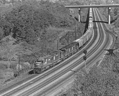 Conrail westbound grain extra, near Ehrenfeld, Pennsylvania, in Cambria County, 1976. (Ivan S. Abrams) Tags: blackandwhite newcastle pittsburgh butler bo ge prr ble conrail alco milw emd ple 2102 chessiesystem westmorelandcounty 4070 bessemerandlakeerie steamtours pittsburghandlakeerie ivansabrams eidenau steamlocomtives ustrainsfromthe1960sand1970s