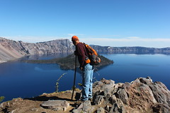 Jim carefully peeks over the edge (rozoneill) Tags: park lake oregon forest river hiking mount national crater rogue siskiyou thielsen wsweekly48