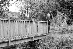 1022 of 1096 (Yr 3) - Mature guy (Hi, I'm Tim Large) Tags: man male mature guy bridge fashion shoot portrait fulllength monochrome blackandwhite old older 60 fuji fujinon fujifilm x70 selfie autoportrait self photographer tripod timer selftimer wood wooden