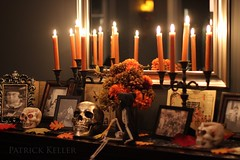 Halloween Altar 9 (BigSéance) Tags: halloweenaltar halloween halloweendecorating halloweendecorations candles candelabras mirror reflection candlelight candleflames skull skeleton flowers vintagehalloween vintage orange