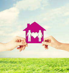 Hands holding ImmoFusion house with family (immofusion) Tags: green house home eco care real estate family property holding showing hands saving ecology protection power environment future new sustain system housing dream shape symbol paper small shelter value ecological accommodation rent buy mortgage apartment investment loan couple man woman people together child love father mother grass blue sky outdoors