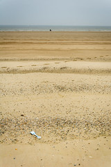 a day at the seaside (stevefge) Tags: dunkirk france beach sand sea coast spade pebbes horizon people landscape empty reflectyourworld