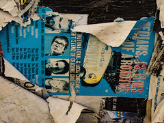 A Real Head Turner (Steve Taylor (Photography)) Tags: hannahgadsby eddieiftt joshthomes chrisbrain torn ripped weathered hangingdown train poster advert paper unstuck blue black yellow white red lady man men woman newzealand nz southisland canterbury christchurch city cbd