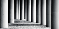 Nihilist (Scintt) Tags: singapore architecture pillars structure concrete building dramatic tones light bw bnw black white mono monochrome desaturated minimal minimalism minimalist simple pano crop panorama textures smooth day sun glow abstract artistic telephoto tokina urban exploration travel scintillation scintt jon chiang photography