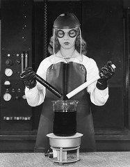 #A laboratory technician lifts two plastic rods from a boiling bath of hot sulfuric acid to demonstrate the newly invented Teflon. 1940s. [540 X 693] #history #retro #vintage #dh #HistoryPorn http://ift.tt/2ehYZDm (Histolines) Tags: histolines history timeline retro vinatage a laboratory technician lifts two plastic rods from boiling bath hot sulfuric acid demonstrate newly invented teflon 1940s 540 x 693 vintage dh historyporn httpifttt2ehyzdm