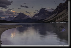 Moon over Bow Lake (Daryl L. Hunter - Hole Picture Photo Safaris) Tags: alberta banffnationalpark bowlake canada daryllhunter fullmoon glacier icefieldsparkwayreflection sunset alpine calm canadianrockies crowfootmountain dream eveninglight nirvana peaceful pinksky serene unitedstates usa