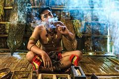 Native (edfy) Tags: native smoking celebration edcheong photojournalism art murut aborigine tobacco pollution hunter jungle rain forest tribe nature natural eco