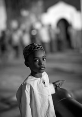 Little Boy Wearing Kofia, Lamu, Kenya (Eric Lafforgue) Tags: africa portrait blackandwhite childhood vertical island photography blackwhite kid child kenya culture unescoworldheritagesite afrika tradition lamu swahili afrique eastafrica qunia lamuisland lafforgue traveldestination africanethnicity kenyaafrica muslimislam  qunia  onechildonly 111328   kea exterioroutdoors   tradingroute blackethnicity a nightobscuritydark