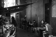 Street Scene (TGKW) Tags: portrait people blackandwhite man table cafe alley sitting eating candid drinking lane roadside macau portugese 6963