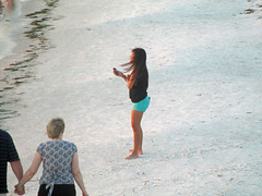 Cute girl taking sunset photos (BuccaneerBoy) Tags: family girls sunset hot cute sexy beach gulfofmexico water fun spring sand legs florida may shore babes clearwaterbeach clearwater
