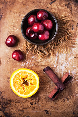 Cherries, Orange, Cinnamon (onegirlinthekitchen) Tags: red stilllife orange macro fruit canon vintage spring cherries farmersmarket cinnamon spice bowl 100mm spanish slice stick produce citrus chiaroscuro sangria props foodphotography