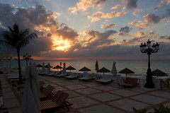 Red Sky at Night (giantmike) Tags: light sunset vacation sky sun tree clouds chairs sandals resort palmtree tropical bahamas umbrellas lounges