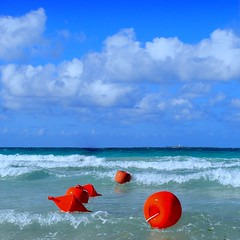 dancing buoys (mujepa) Tags: blue red sea green beach cuba varadero salsa buoys buoyant yearend15