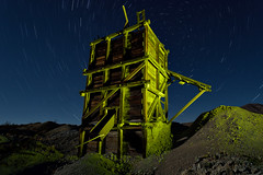 gold box. mojave desert, ca. 2016. (eyetwist) Tags: eyetwistkevinballuff eyetwist night abandoned ruins gold ore bin mine mining urbex mojavedesert nikon nikond7000 d7000 nikkor capturenx2 1024mmf3545g fullmoon photography desert arid dark longexposure moonlight moonlit gel npy nocturne highdesert mojave california long exposure wideangle stars startrails northstar polaris spin light painting lightpainting forgotten ruin decay architecture faded weathered exploring saturated yellow industry industrial rock wreckage tailings rocks wood timbers tungsten