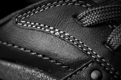 Stitch (Harry McGregor) Tags: stitch hmm macromondays nikon d3300 harrymcgregor 19 november 2016 trainer footwear shoe bw blackandwhite monochrome laces laced leather indoor explore