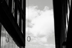 hanging (Dean Forbes) Tags: wire loop building construction seattle downtown bw windows sky clouds