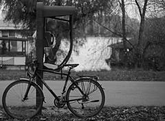 Communication (salaminijo) Tags: blackandwhite monochrome bike vehicle outdoor telephonbox light bicycle crnobela bw day november atmosphere brokenbox communication bicikl dan canon eos 1d markiii 50mm18ii beograd belgrade ser