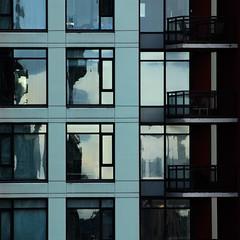 face to face (dotintime) Tags: face building glass window balcony reflection neighbor adjacent light dark geometry line stack shelf tier row column architecture residence dotintime meganlane