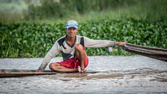 Holding tight (Channed) Tags: asia azië birma burma inlaylake inlelake myanmar shan myanmarbirma man boat water lake meer boot channedimages chantalnederstigt