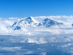 Himalayan Mountain peaks piercing through the thick clouds as seen from plane window - Nepal (PsJeremy) Tags: nepal himalaya clouds windowseat plane abovetheclouds