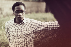 - untitled - (Philip Kisia) Tags: portrait portaits dof depth field nature afro ebony nubian african male man glasses plaid bark tree brown east africa kenya kenyan nairobi red pelz pelzphotography shadow outdoors outdoor suburb suburbia