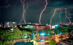 Bolts from the blue! (Shutterfreak ) Tags: street storm car night buildings landscape nikon horizon trails atmosphere dhaka lightning bangladesh hasin d5000 inkiad