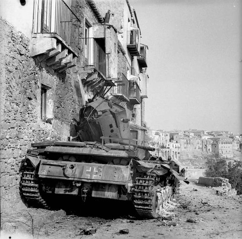 The Drive for Messina 10 July - 17 August 1943: A German Mk III tank knocked out during the fierce street fighting in Centuripe