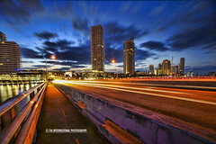South Beach City Grand Prix (TIA International Photography) Tags: ocean county city morning travel bridge blue vacation urban cloud game beach skyline race marina sunrise tia landscape real concrete dawn hotel golden bay coast early video spring community highway long exposure cityscape escape estate traffic motorway florida miami south overpass pedestrian grand racing atlantic east route prix sidewalk condo walkway hour commute promenade tropical leisure pointe interstate expressway southeast guardrail residence condominium tosin springtime daybreak biscayne 395 miamidade a1a realty arasi tiascapes tiainternationalphotography