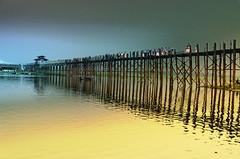 U Bein foot bridge (Artypixall) Tags: sunset people reflections boats burma getty myanmar mandalay pedestrianbridge faa amarapura irrawaddyriver ubeinfootbridge