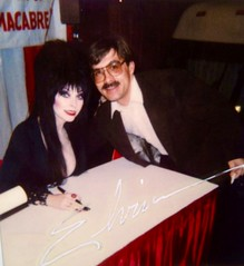 #48c-11A, Elvira, At The World Of Wheels (Picture Proof Autographs) Tags: fredweichmann photograph photographs inperson pictureproof photoproof picture photo proof image images collector collectors collection collections collectible collectibles classic session sessions authentic authenticated real genuine sign signed signing sigature sigatures tv movie movies show shows celebrity celebrities new news nbc abc cbs hollywood screenshots screenshot screen onset set lights cameria action lightscameriaaction film filming star stars extra extras background fred frederick weichmann frederickweichmann pictures with fan fans celebirties elvira