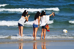 Selfie for surf sisters (Roving I) Tags: ocean travel sea tourism beach photography surf longhair tourists vietnam danang selfies jeansshorts