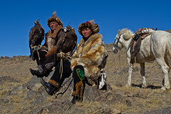 Eagle hunters in the surroundings of Olgyi, Mongolia (NeSlaB .) Tags: travel colors look hat canon photo asia eagle traditional country culture photojournalism clothes mongolia ornaments l tradition ethnic society kazakh developingcountries hunters reportage nationalgeographic ethnography ethnology ethnies neslab davidecomelli