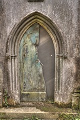 halved (stevefge) Tags: uk london highgate cemetary crypt doors tonemap graveyard reflectyourworld