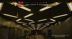 Strolling on the lighted hallway (Carlos E. Gmez) Tags: newyorkcity mta new york city transit broadway fulton subwaystation sony sonyalphaslta55v carlzeiss1680mmf3545zalens downtownmanhattan photoshop cc